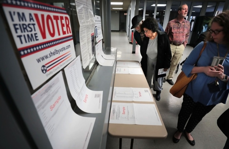 <strong>Joyce and Christopher Washington (left) read through the sample ballots at the Mississippi Boulevard Christian Church polling location as voters go to the polls on March 3, 2020.</strong> (Jim Weber/Daily Memphian)