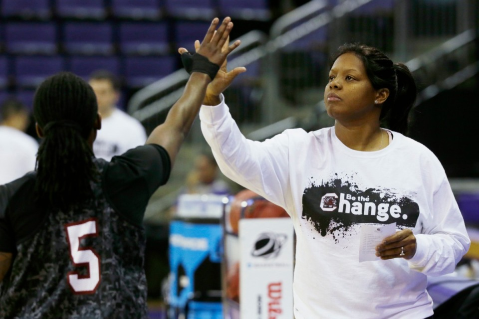 <strong>Then-South Carolina assistant coach Nikki McCray, pictured on March 22, 2014, high-fives guard Khadijah Sessions during practice at the NCAA women's college basketball tournament in Seattle. The former college all-American had a record-setting career at Collierville High and will become the next women&rsquo;s basketball coach at Mississippi State.</strong> (AP Photo/Ted S. Warren, File)