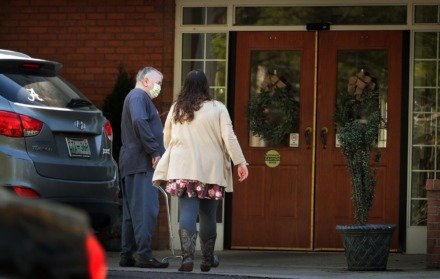 <strong>An elderly resident returns home with help from a relative on April 1, 2020, at the Carriage Court assisted living facility in East Memphis where five residents and an employee tested positive for COVID-19.</strong> (Jim Weber/Daily Memphian)