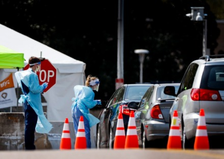 <strong>Staff and students from the University of Tennessee Health Science Center work with the Shelby County Health Department on April 1, 2020, to continue drive-thru testing for COVID-19 at the Memphis Fairgrounds.</strong> (Mark Weber/ The Daily Memphian)