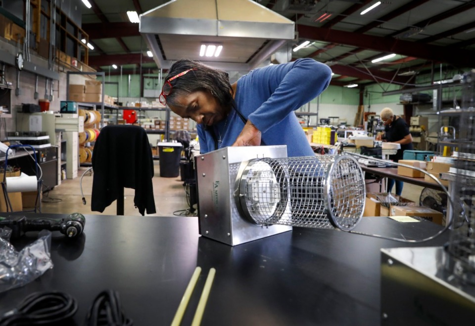 <strong>EvergreenUV Environmental Disinfection employee Claudine Duncan assembles a UVC unit for shipping on Tuesday, April 7. The company manufactures a UVC device that will kill all known airborne pathogens, including COVID-19. Last year the company sold 30 devices; now they have a backlog of more than 1,000 orders.</strong> (Mark Weber/Daily Memphian)