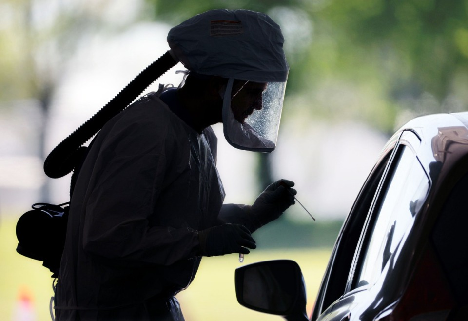 <strong>A doctor prepares to test a patient for COVID-19 at the drive-thru testing facility at Tiger Lane April 10, 2020.</strong> (Patrick Lantrip/Daily Memphian)