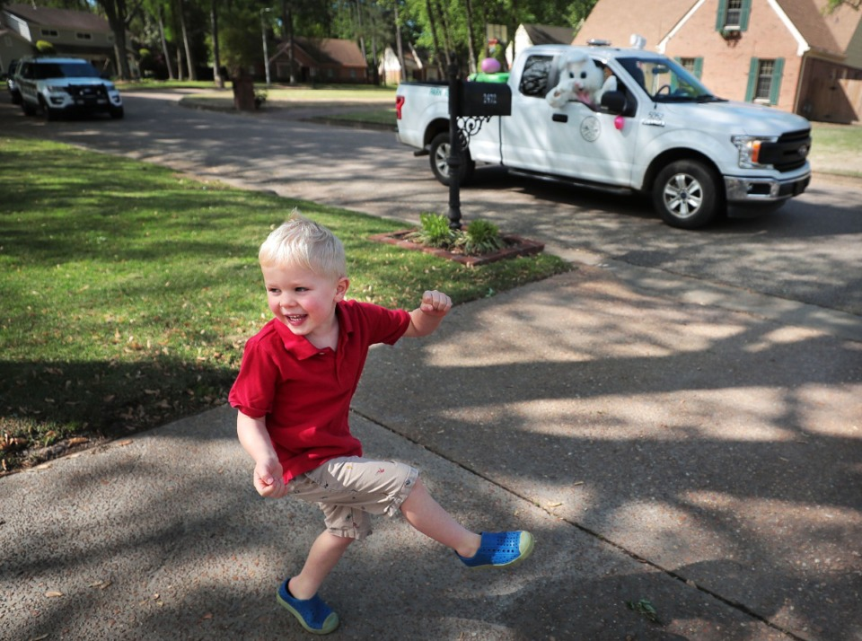 <strong>Ned Stroup, 4, dances his way down the driveway as Germantown Parks and Recreation helps local kids get their big-bunny fix in an era of social distancing . The Easter Bunny, played by volunteer J.D. McMillian, was driven around several Germantown neighborhoods on April 11, 2020, to visit over 200 families who signed up on Facebook. As part of the event, kids were encouraged to show their best dance moves while the rabbit played a mix of music including (but not limited to) hip-hop.</strong> (Jim Weber/Daily Memphian)
