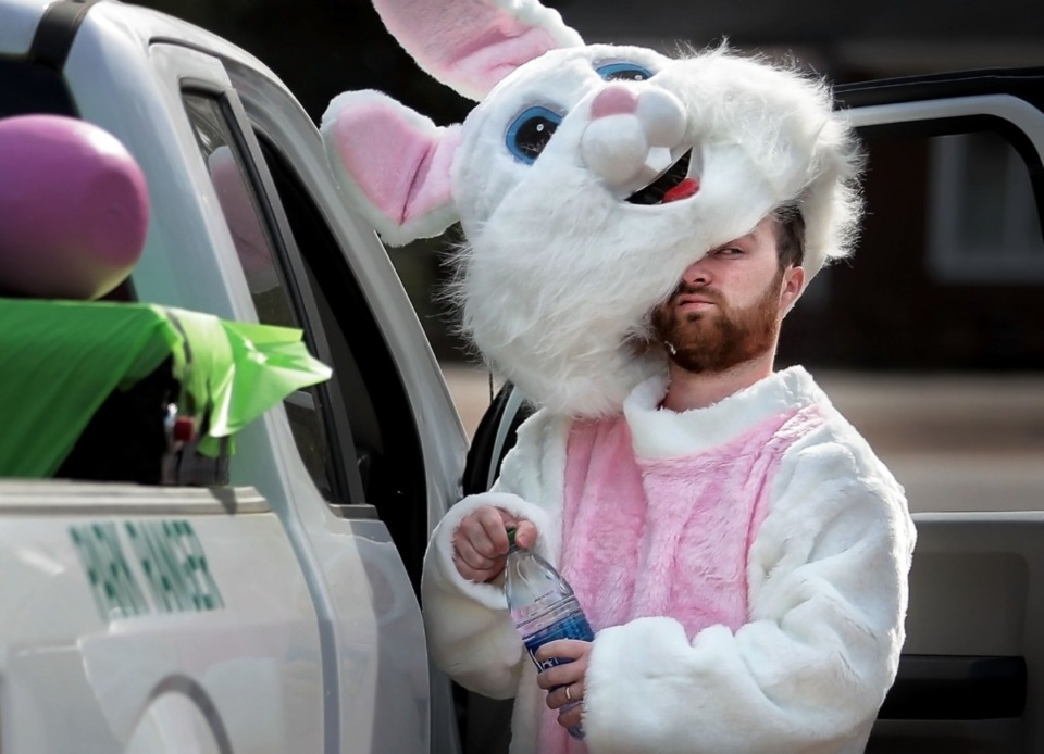 <strong>Volunteer bunny J.D. McMillian hydrates before a long truck ride as Germantown Parks and Recreation helps local kids get their big-bunny fix in an era of social distancing on April 11, 2020.</strong> (Jim Weber/Daily Memphian)