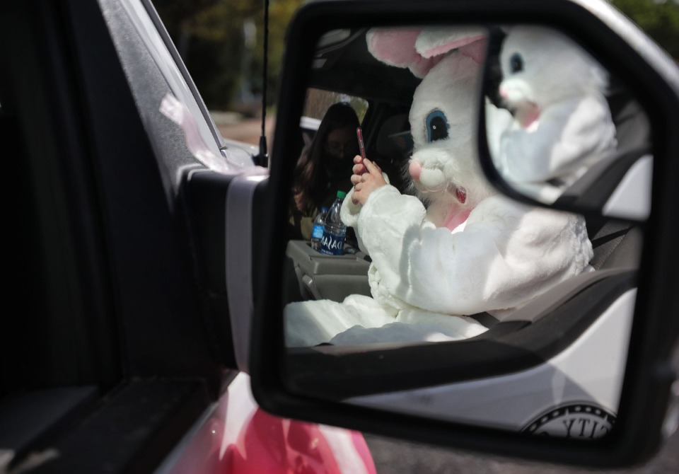 <strong>Volunteer bunny J.D. McMillian gets ready for a long truck ride as Germantown Parks and Recreation helps local kids get their big-bunny-fix in an era of social distancing by driving&nbsp; around several Germantown neighborhoods on April 11, 2020, to visit over 200 families who signed up on Facebook.&nbsp;</strong> (Jim Weber/Daily Memphian)