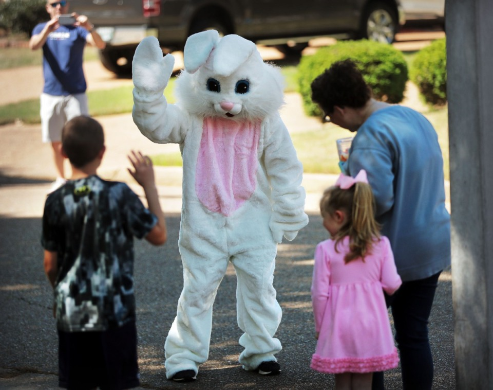 <strong>Volunteer bunny J.D. McMillian jumps out of the truck for a little dance of his own as Germantown Parks and Recreation gives kids their big-bunny fix in an era of social distancing on April 11, 2020.</strong> (Jim Weber/Daily Memphian)