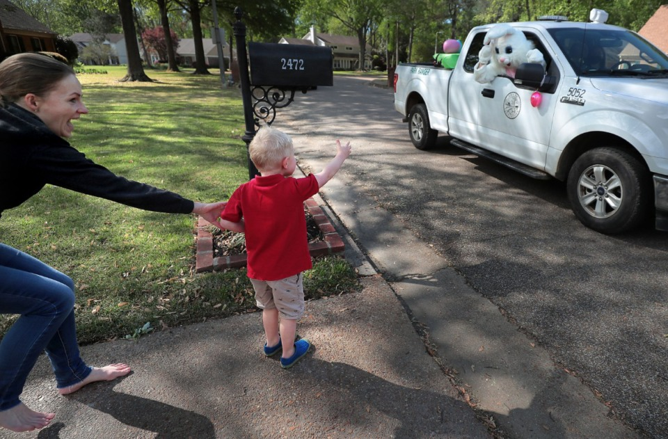 <strong>Ned Stroup, 4, starts to wander a little too close to the big rabbit as Germantown Parks and Recreation takes the Easter Bunny to several Germantown neighborhoods on April 11, 2020, to visit over 200 families who signed up on Facebook to be on the bunny's route.&nbsp;</strong> (Jim Weber/Daily Memphian)