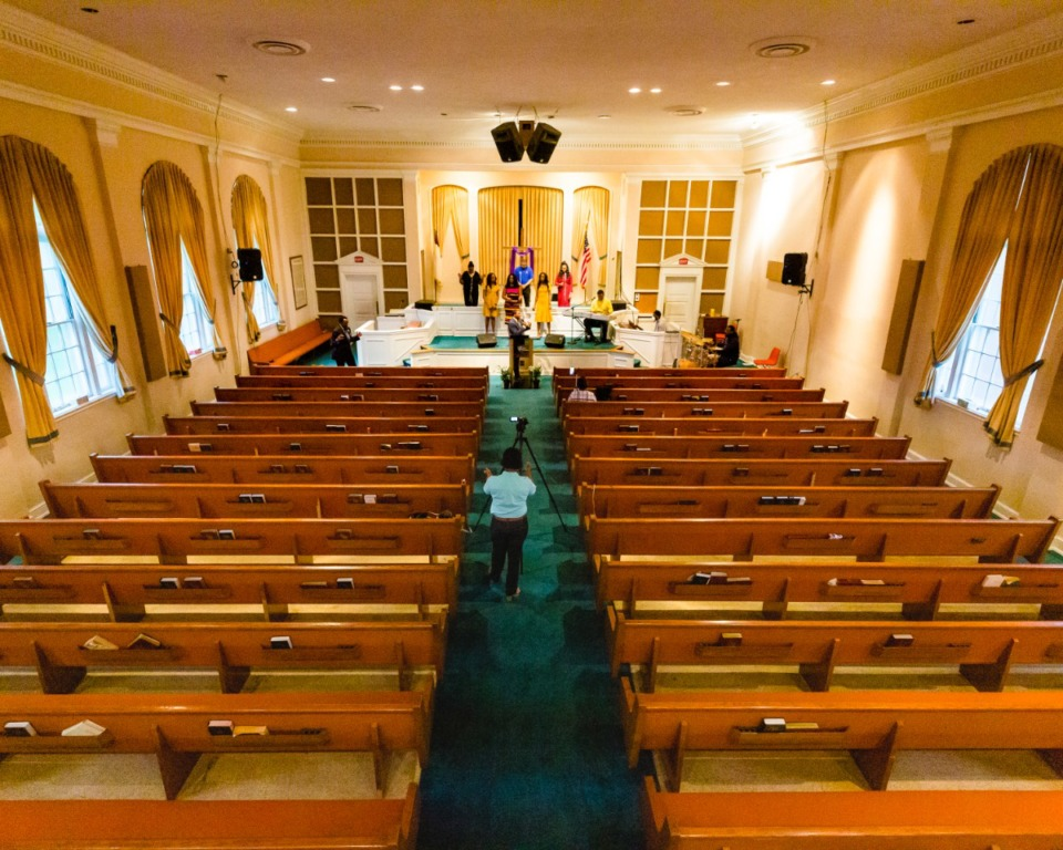 <strong>Rev. Wayne Gillard II preaches to empty pews Sunday morning during a Facebook Live Easter sermon at Monument of Love Church in Orange Mound on April 12, 2020.</strong> (Ziggy Mack/Special to Daily Memphian)