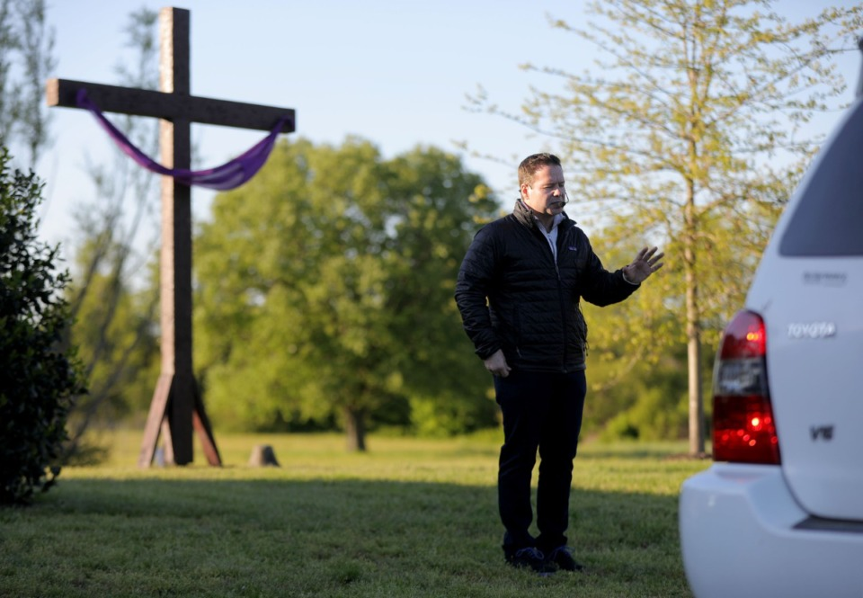 <strong>Chris Foster, lead pastor of the Cathedral of Praise church, blesses a parishoners car during his church's Good Friday Drive-Thru Communion service April 10, 2020.</strong> (Patrick Lantrip/Daily Memphian)