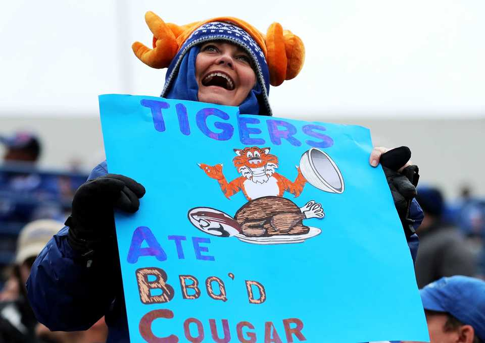 "<strong>A University of Memphis fan reacts to a Tigers touchdown&nbsp;<span class=""s1"">during a game with the Houston Cougars on Friday, Nov. 23, at Liberty Bowl Memorial Stadium.</span></strong>(Houston Cofield/Daily Memphian)"