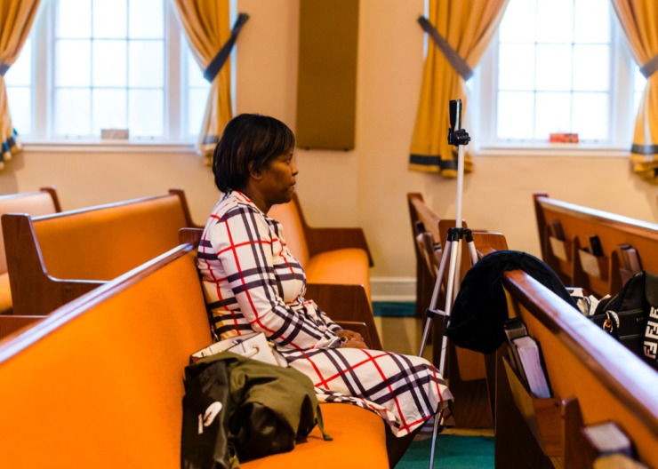 <strong>Sharon Green operates the camera during a Facebook Live Easter sermon amidst empty church pews inside Monument of Love Church in Orange Mound on Sunday, April 12, 2020.</strong> (Ziggy Mack/Special to Daily Memphian)