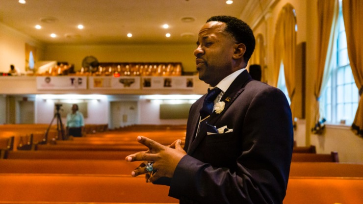 <strong>Pastor Derrick Joyce enjoys the music during Facebook Live Easter sermon amidst empty church pews inside Monument of Love Church in Orange Mound on Sunday, April 12, 2020.</strong> (Ziggy Mack/Special to Daily Memphian)