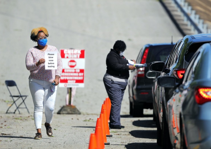 <strong>A health care worker reminds patients to blow their noses before getting tested at Christ Community Health's drive-thru COVID-19 testing site in Whitehaven on April 13, 2020.</strong> (Patrick Lantrip/Daily Memphian)