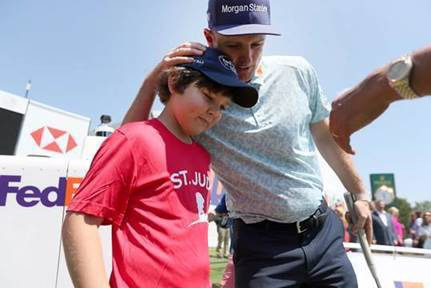 <strong>St. Jude patient Dakota Cunningham (left) receives a hug from Justin Rose. The two met during the 2019 WGC-FedEx St. Jude Invitational.&nbsp;</strong>(<em>Submitted</em>)