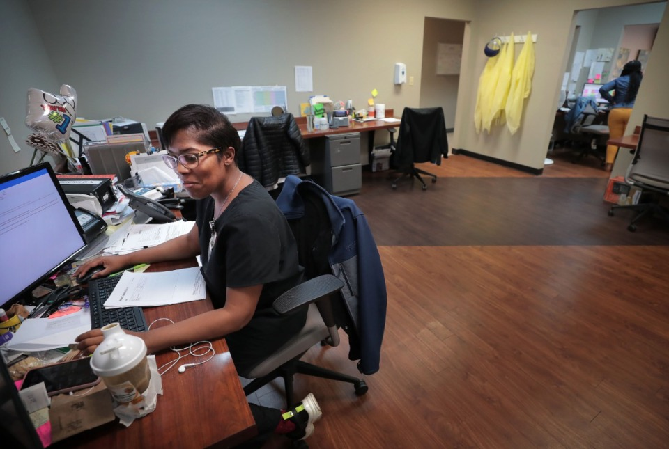 <strong>Tangie Jones helps patients with their prescriptions and health concerns on the telehealth desk at the Cherokee Healthcare clinic in Frayser on April, 14, 2020.&nbsp;</strong>(Jim Weber/Daily Memphian)