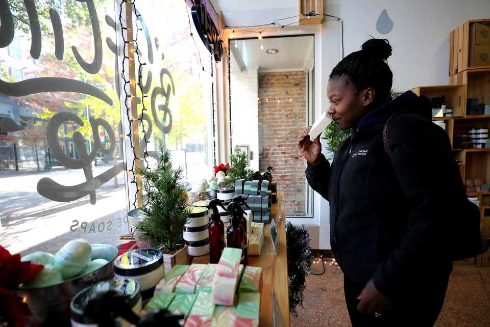 <strong>Kimbra McBride, a regular shopper at Buff City Soap, browses the store's soap selection to restock her bathroom. Buff City Soap is among the Memphis businesses participating in Small Business Saturday to promote an alternative to big-box stores.</strong> (Houston Cofield/Daily Memphian)