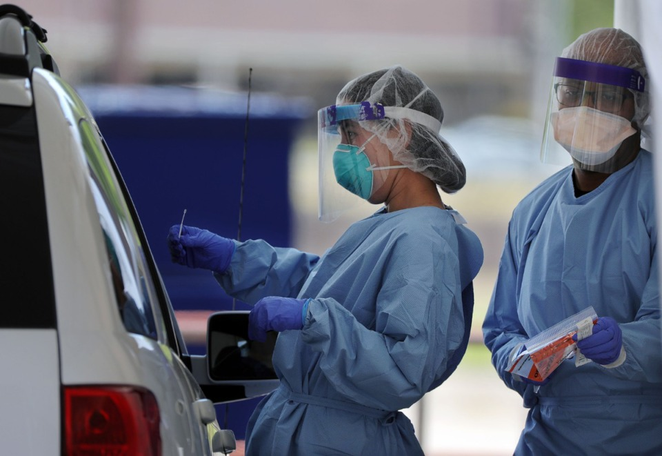 <strong>A doctor prepares to swab a patient at Christ Community Health's drive-thru COVID-19 testing site in Whitehaven April 13, 2020.</strong> (Patrick Lantrip/Daily Memphian)