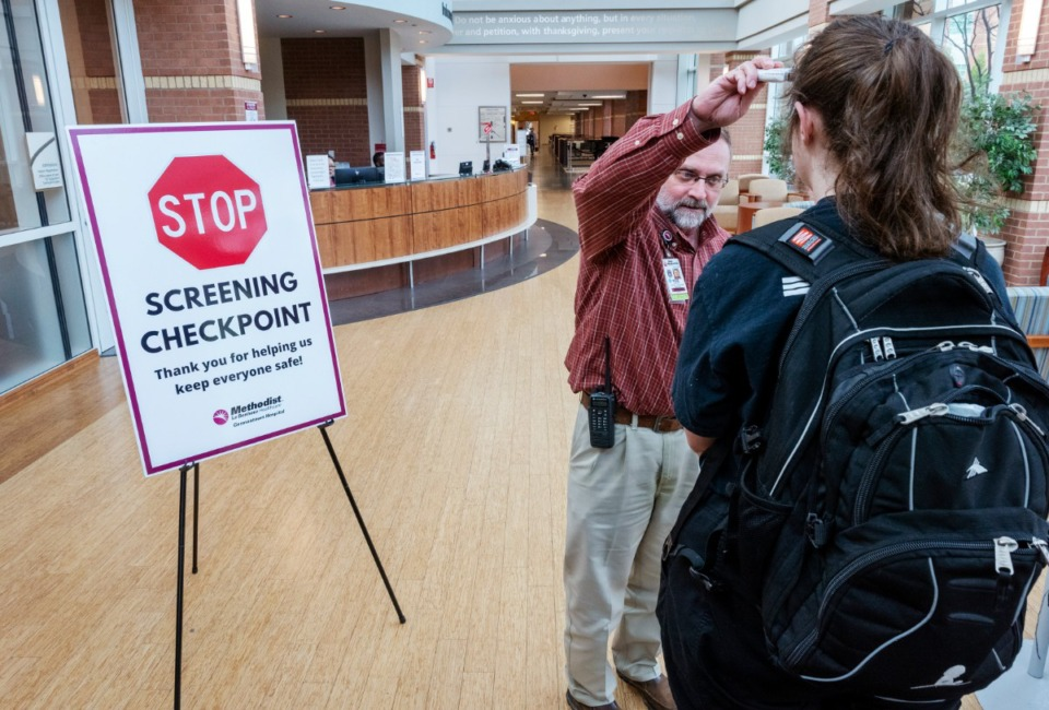 <strong>Rob Crafford screens a staff member at Methodist-LeBonheur Germantown as they enter the hospital on March 19, 2020. A total of 137 people were hospitalized in Memphis as of Tuesday, April 14, with COVID-19 and another 95 were hospitalized while under investigation for having the virus.</strong> (The Daily Memphian file)