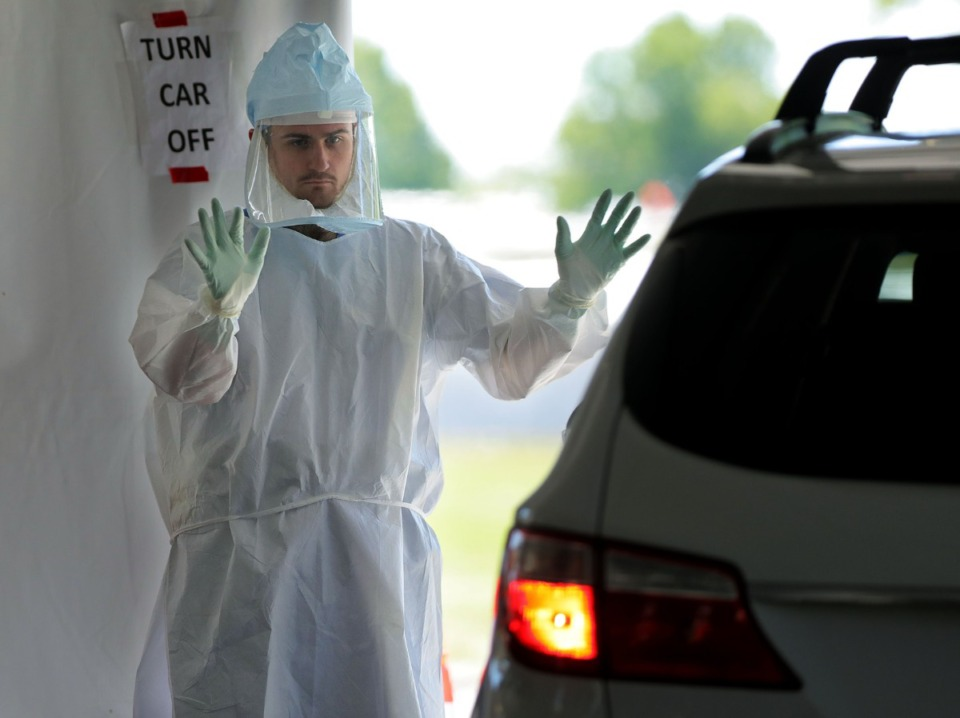 <strong>A doctor waves a possible COVID-19 patient in for testing at UTHSC&rsquo;s Tiger Lane testing site April 10, 2020.</strong> (Patrick Lantrip/Daily Memphian)