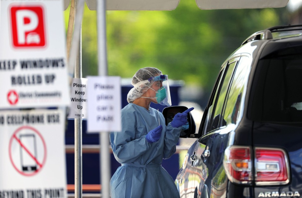 <strong>A doctor jokes with a patent at Christ Community Health's drive-thru COVID-19 testing site in Whitehaven April 13, 2020.</strong> (Patrick Lantrip/Daily Memphian file)