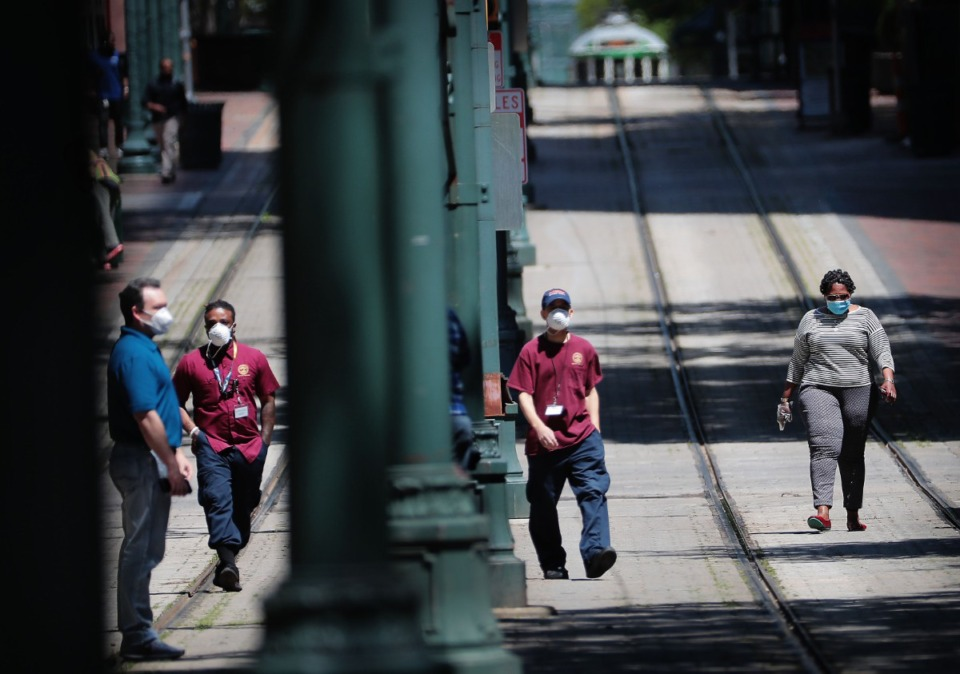 <strong>Memphians (some masked) go about their business on the Main Street mall on April 16, 2020. New numbers by Unicast, a company that uses cell phone data to track human mobility, suggest that Shelby County residents aren't doing enough social distancing.</strong> (Jim Weber/Daily Memphian)