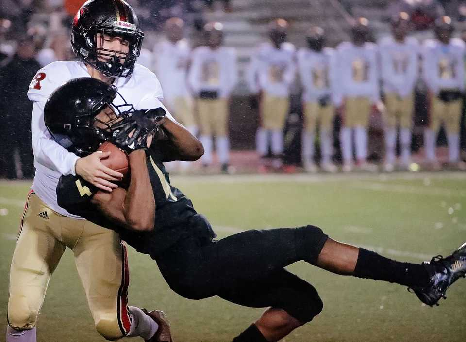 <strong>Whitehaven's Devin Boddie jr. (4) comes down with a reception under pressure by Ravenwood's Ian Gatlin during the state Class 6A semifinal playoff game at Whitehaven High on Nov 23, 2018.</strong> (Jim Weber/Daily Memphian)