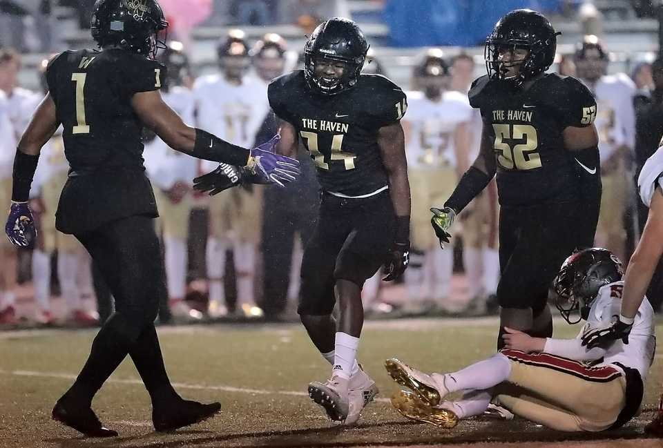 <strong>Whitehaven High's Keveon Mullins (14) celebrates a sack with Bryson Eason (1) during Whitehaven's state semifinal playoff game against Ravenwood at Whitehaven on Nov 23, 2018.</strong> (Jim Weber/Daily Memphian)