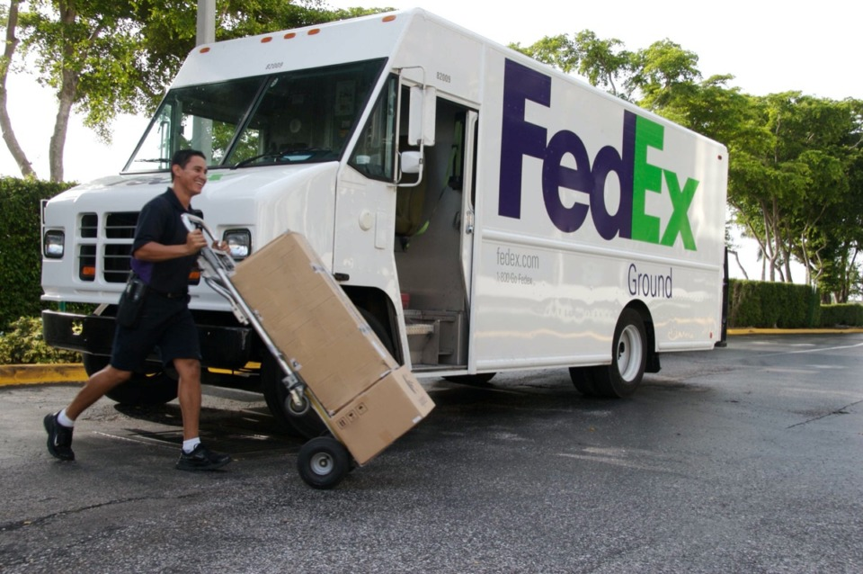 <strong>A FedEx Ground employee (in a file photo) delivers a package to a residential customer. An increase in ecommerce due to the coronavirus pandemic could raise profits if the company can reduce the cost of residential delivery.</strong>&nbsp;(Daily Memphian file)
