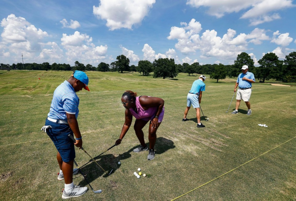 <strong>First Tee assistant executive director Mackenzie Mack (second from left) works with Daylon Dockery (left) on his golf stance and swing during an event at the Links at Whitehaven Golf Course on July 20, 2019.&nbsp;The city golf course will reopen Saturday, April 18, in the first loosening of restrictions during the COVID-19 pandemic. </strong>(Mark Weber/Daily Memphian file)