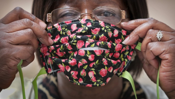 <strong>Corrections program specialist Gloria Phillips shows a finished product as inmates at the Shelby County Correctional Center learn how to make fabric masks on April, 17, 2020, in the midst of the coronavirus pandemic.&nbsp;</strong> (Jim Weber/Daily Memphian)