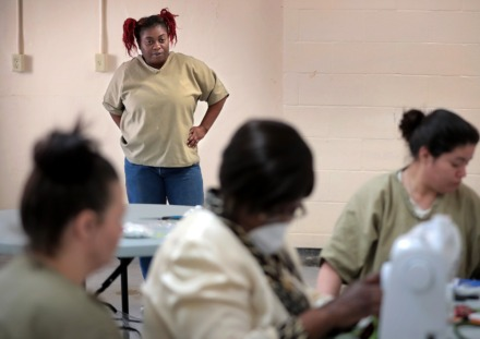 <strong>Whanasakia Ledlow (left) watchs from a safe distance as inmates at the Shelby County Correctional Center learn how to make fabric masks on April, 17, 2020.</strong> (Jim Weber/Daily Memphian)