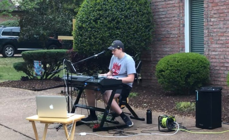 <strong>Isaac Schmidt sets up his keyboard and microphone in his driveway. Each weekend he performs his own setlist for his neighbors in Collierville. </strong>(S<em>ubmitted by Bethany Schmidt</em>)