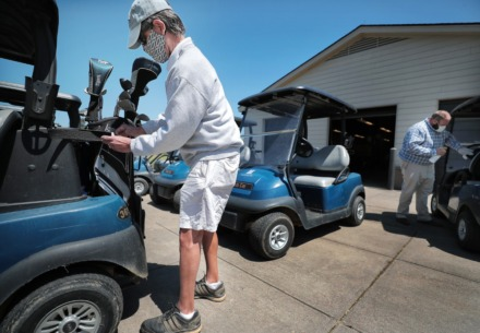 <strong>Rick Mason loads up his clubs as golfers return to the Links at Whitehaven golf course on April 18, 2020, on a trial basis to test whether golfers would adhere to social distancing requirements during play. </strong>(Jim Weber/Daily Memphian)