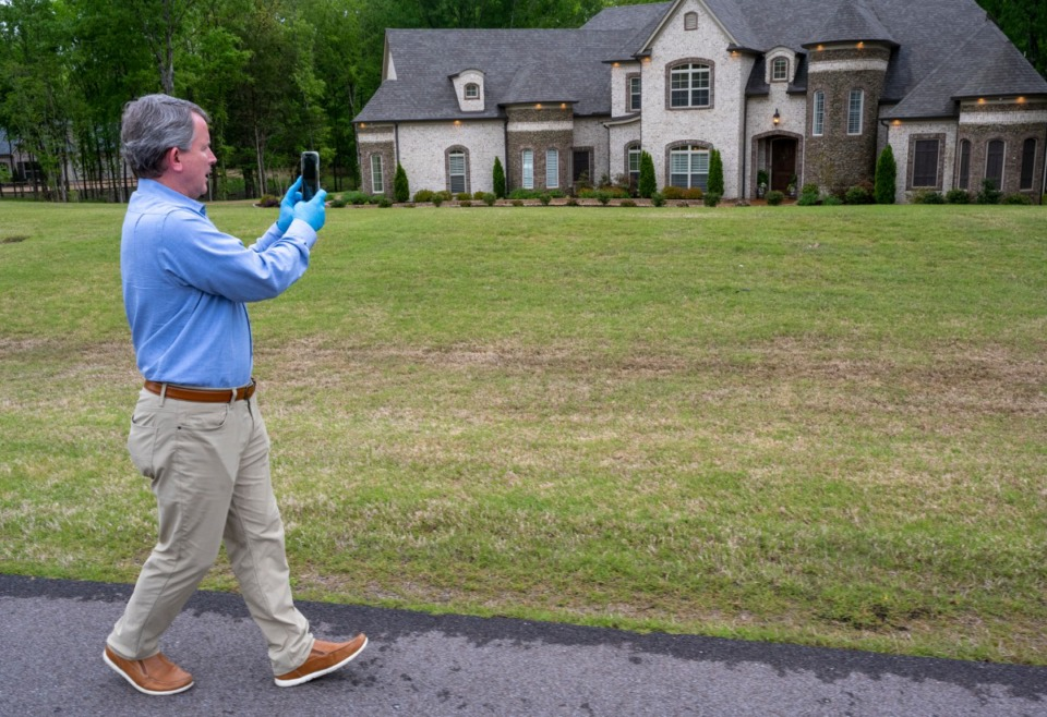 """<strong>While social distancing, Realtor Donnie Chambliss holds an """"open house"""" via his Facebook Live Sunday, April 19, 2020 in Olive Branch.</strong> (Greg Campbell/Special to The Daily Memphian)"""