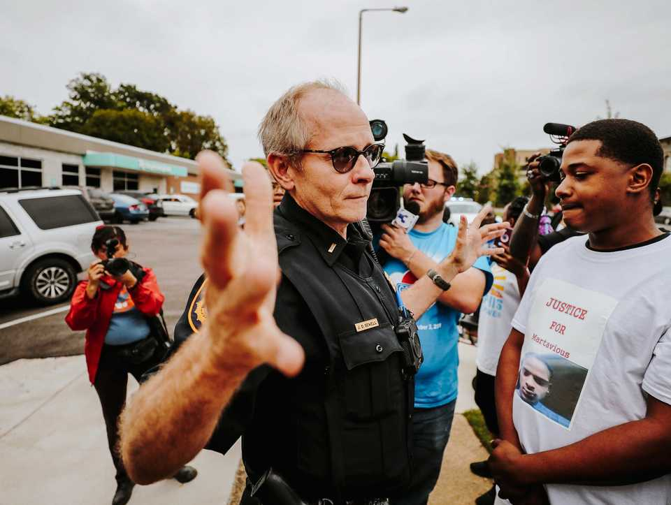 <strong>MPD officer J.D. Sewell tells protesters to stop blocking the door of the Memphis Police Association during a September 2018 protest and press conference following the officer-invoved shooting of Martavious Banks.</strong> (Houston Cofield/Daily Memphian file)