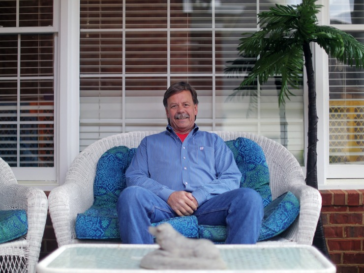 <strong>Hans Guenther sits on his back porch in Germantown on April 14, 2020. Despite living an active lifestyle, the 62-year-old contracted COVID-19 and had to be hospitalized. Now, home and fully recovered, Guenther hopes to donate his plasma with the hopes of saving lives.</strong> (Patrick Lantrip/Daily Memphian)