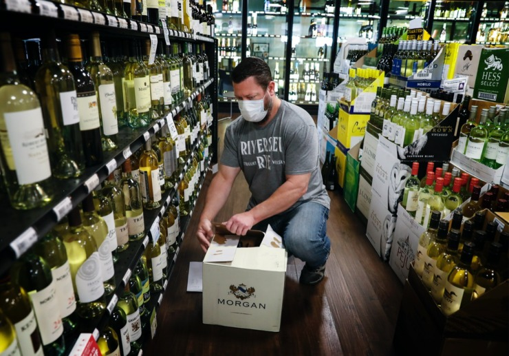<strong>Buster's employee Chris Miller fills online alcohol orders on Thursday, April 16, 2020. Buster's has taken its business totally online since the implementation social distancing guidelines after the coronavirus outbreak.</strong> (Mark Weber/Daily Memphian)