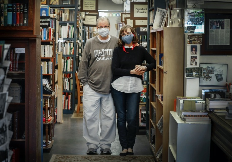 <strong>Burke's Bookstore owners Corey and Cheryl Mesler stand among their books on Thursday, April 16, 2020, in Cooper-Young.</strong> <strong>The bookstore has been open since 1875, and is now hand-delivering books to customers.</strong> (Mark Weber/Daily Memphian)
