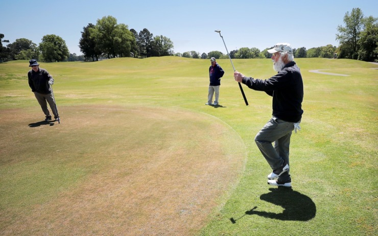 <strong>Lou Albonetti (right) reacts to a missed putt while Bill Sheppard (left) and Ray Duncan watch on from the edge of the green as golfers return to the Links at Whitehaven golf course on April 18, 2020, on a trial basis to test whether golfers would adhere to social distancing requirements during play. Only one person was permitted per cart and golfers were not allowed to handle the flag.&nbsp;</strong>(Jim Weber/Daily Memphian)