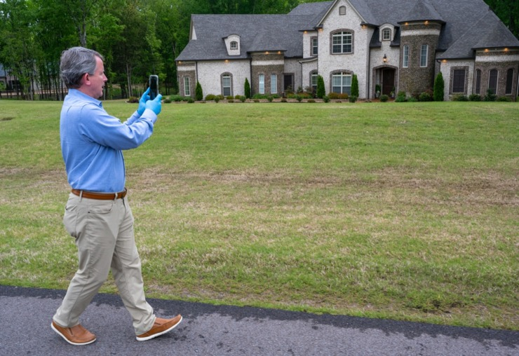 <strong>Realtor Donnie Chambliss with Crye-Leike starts his Facebook Live open house tour Sunday, April 19, 2020 in Olive Branch, Mississippi. The corona virus has forced virtual open houses for real estate agents to show and sell homes.</strong> (Greg Campbell/Special for The Daily Memphian)