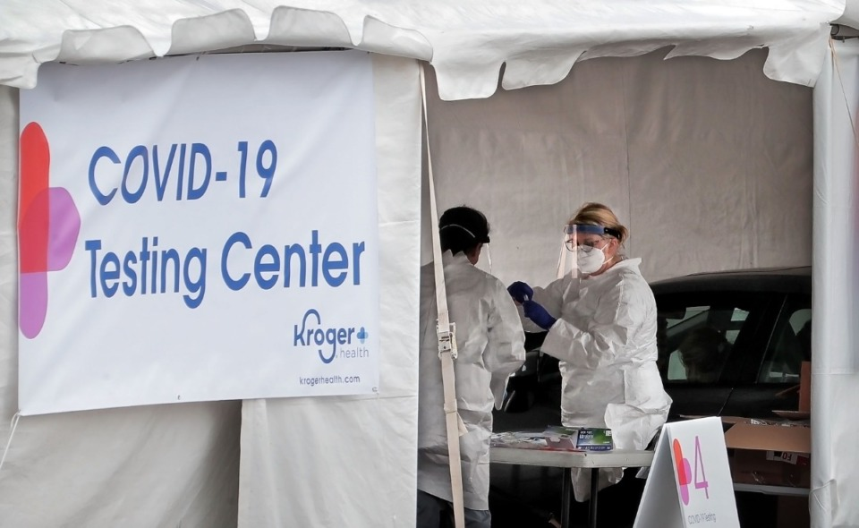 <strong>Medical technicians and nurses collect samples as staff from Cherokee Health and Kroger team up to offer a limited 3-day run of free drive-thru COVID-19 testing for people with symptoms, healthcare workers and first responders in the parking lot at the Memphis Business Academy in Frayser on April 22, 2020.</strong> (Jim Weber/Daily Memphian)