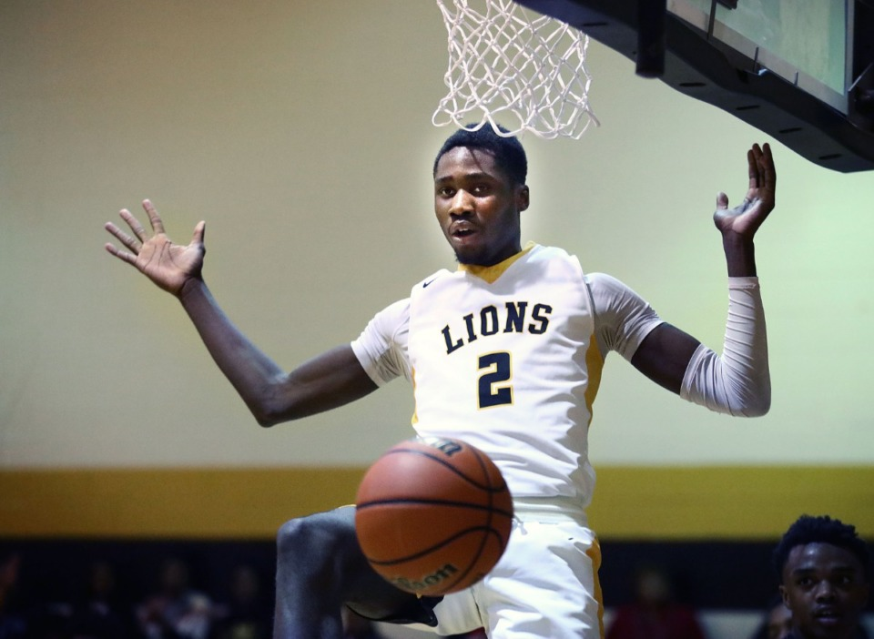 <strong>Memphis Academy of Health Sciences forward David Dixon finishes a dunk during a home victory against Trezevant High School on Jan. 28. Dixon</strong>&nbsp;<strong>has been selected to the Class A all-state basketball team.&nbsp;</strong>(Patrick Lantrip/Daily Memphian file)
