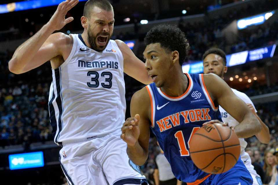 <strong>New York Knicks guard Allonzo Trier, right, drives against Memphis Grizzlies center Marc Gasol (33) in the first half of an NBA basketball game Sunday, Nov. 25, at FedExForum.</strong> (Brandon Dill/Associated Press)