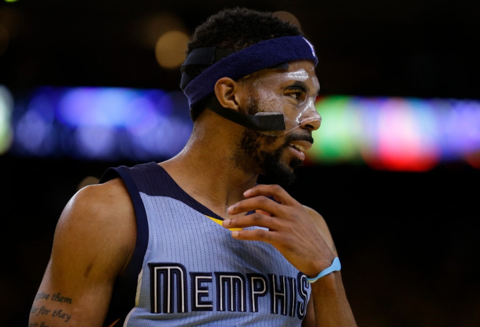 <strong>Memphis Grizzlies' Mike Conley celebrates a score against the Golden State Warriors during the fourth quarter in Game 2 in a second-round NBA basketball playoff series Tuesday, May 5, 2015, in Oakland, Calif.</strong> (Ben Margot/AP file)