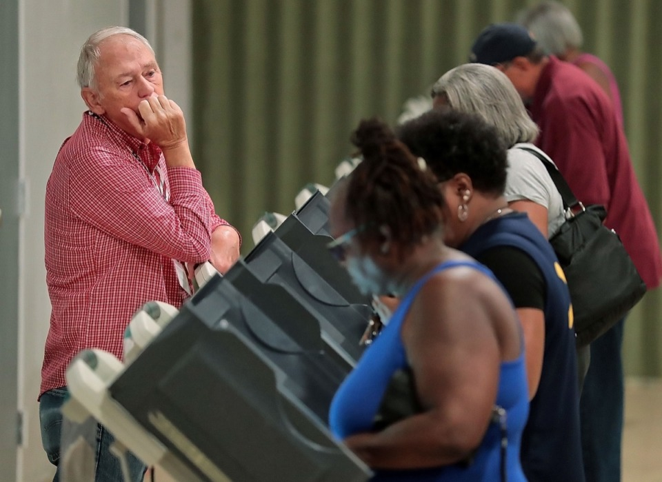 <strong>Poll worker Thomas Rogers watches a steady stream of voters cast their ballot on Sept. 28, 2019.</strong> (Jim Weber/Daily Memphian)