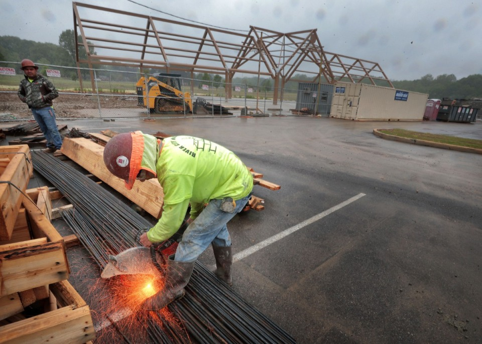 <strong>Danilo Gorza cuts rebar while working on a restroom building next to the Keith McDonald Pavilion at W.J. Freeman Park in Bartlett on Thursday, April 23. The project is one of two large municipal construction projects that recently started in Bartlett.</strong>&nbsp;(Jim Weber/Daily Memphian)