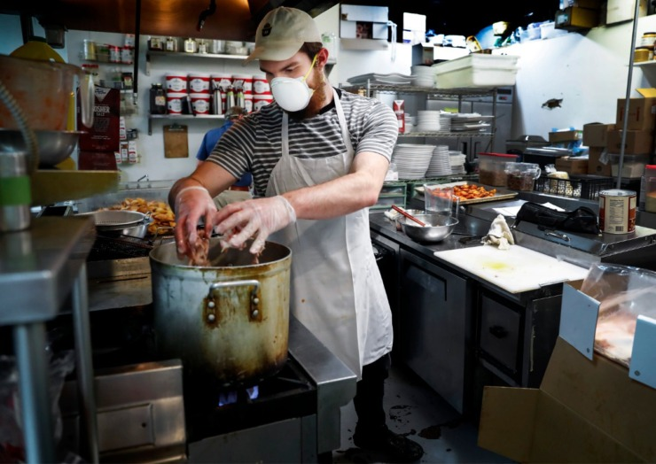 <strong>Sweet Grass&nbsp; cook Collin Cook works on prepping dinner orders on Tuesday, April 21, 2020.</strong> (Mark Weber/Daily Memphian)