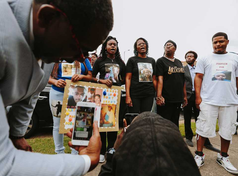 <strong>The family of Martavious Banks joined about two dozen other protesters to hold a press conference and protest in front of the police association where office Mike Williams is stationed. Williams's son, Mike Williams, Jr., also an MPD officer, was involved in the shooting of Martavious Banks.</strong> (Houston Cofield/Daily Memphian)