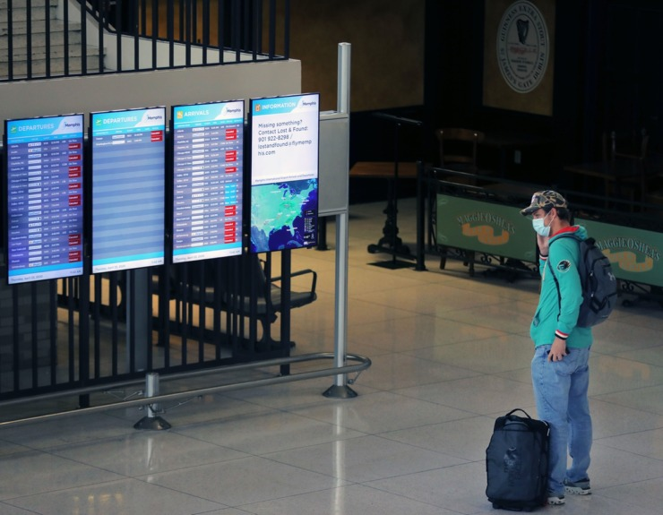<strong>A lone passenger checks the flight information display system at Memphis International Airport on Thursday, April 23. The display showed roughly two dozen canceled flights.&nbsp;<span>Memphis International Airport officials are exploring moving all passenger airlines to a single concourse to save money during the air travel shutdown caused by coronavirus.</span></strong><span> </span> (Patrick Lantrip/Daily Memphian)