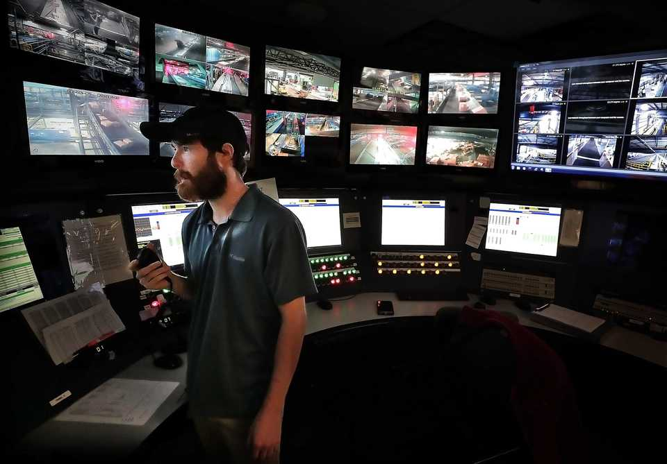 <strong>Central Control Operator Dakota Garrity keeps an eye on operations at the FedEx Ground Hub in Olive Branch, Mississippi on Nov 15, 2018 which is presently undergoing it's third expansion including the addition of new technology to help increase capacity and efficiency.</strong> (Jim Weber/Daily Memphian)